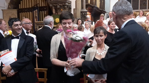 Caroline Summers (contralto soloist) receiving flowers from Allan Lloyd