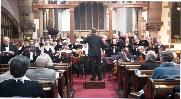The choir and soloists in full voice